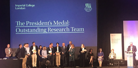 the Paediatric Infectious Diseases Team on stage receiving the award from Imperial College London president, Prof Alice Gast