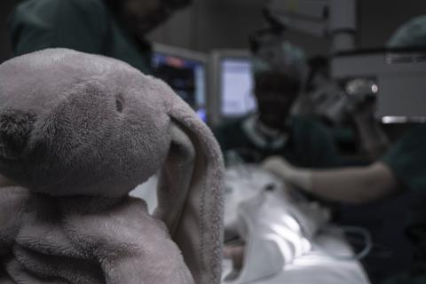 medical operation in process foregrounded by a Bunny rabbit soft toy